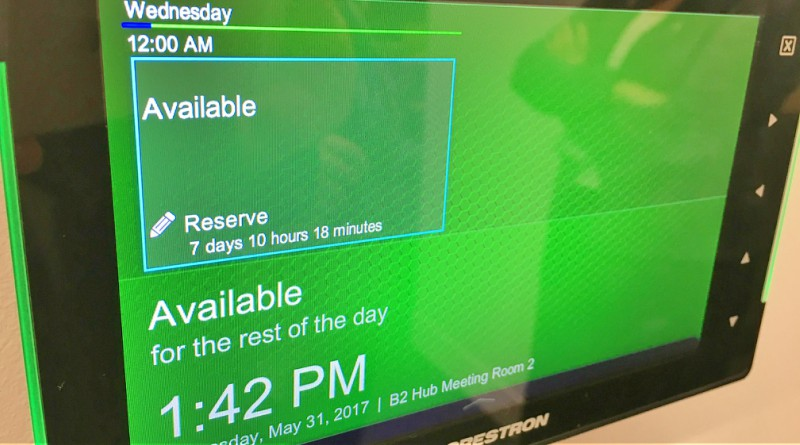 Interactive screens show if a meeting room is available, and how long for. under Blacktown Hospital's new ways of working spaces.