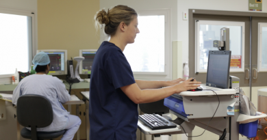 A nurse accessing electronic record records for patient care.